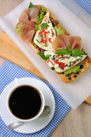 morsel: Sandwich with mozzarella and jamon on ciabatta with a cup of coffee