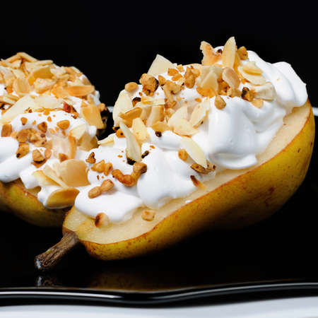 lunch hour: pears with whipped cream sprinkled   nuts and almonds