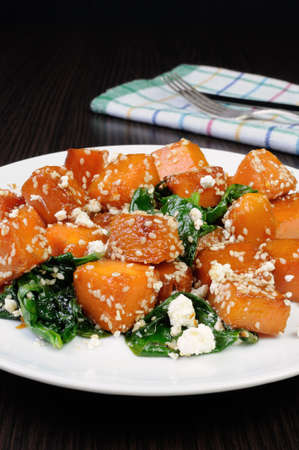elevenses: Slices of pumpkin baked with spinach and sesame seeds