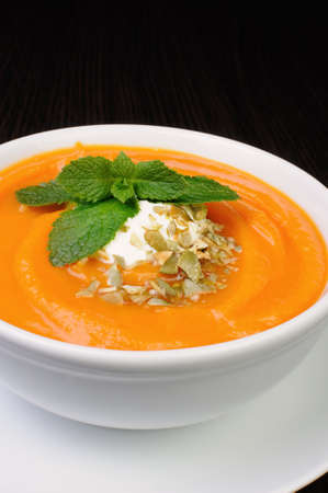 elevenses: Pumpkin soup with sour cream sauce flavored  pumpkin seeds  and mint