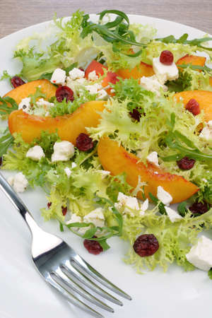 elevenses: Salad of lettuce and arugula with peaches, feta cheese, cranberries