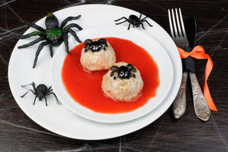 lunch hour: chicken meatballs in tomato gravy on the table in honor of Halloween Stock Photo