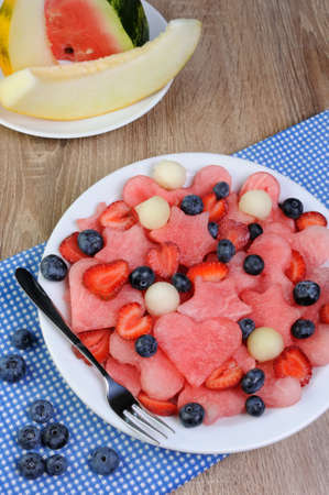 elevenses: salad of blueberries, watermelon hearts, stars, balls of melon and strawberries