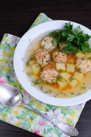 sprinkled: chicken broth of potatoes, carrots and meatballs sprinkled with dill
