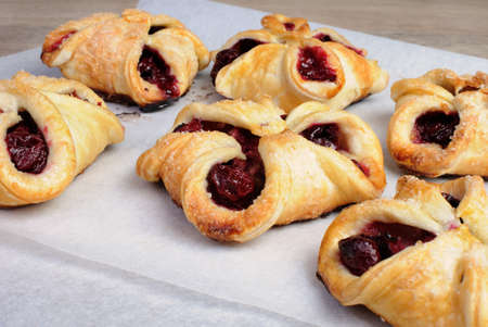 puff pastry: Bun puff pastry stuffed with cherries Stock Photo