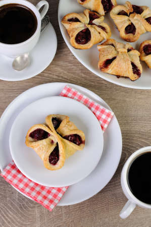 lunch hour: Bun puff pastry stuffed with cherries Stock Photo