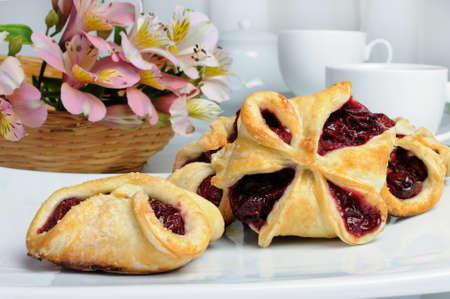 Bun puff pastry stuffed with cherries Stock Photo