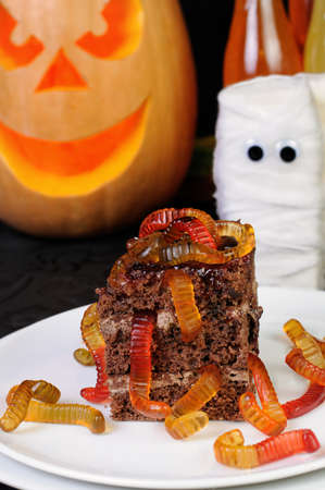 tidbit: piece of chocolate cake with jelly worms Stock Photo