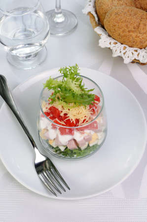 elevenses: Salad of lettuce with egg, ham, tomatoes, dressed   yogurt and cheese Stock Photo