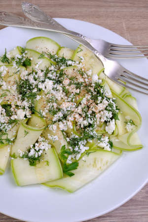 lunch hour: Salad with strips of zucchini, ricotta, dill and spices Stock Photo