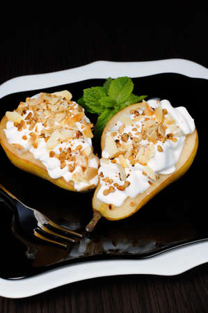 tidbit: pears with whipped cream sprinkled   nuts and almonds