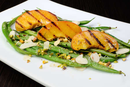elevenses: Salad of green beans , peaches, almonds, pistachios and sprinkled with Parmesan