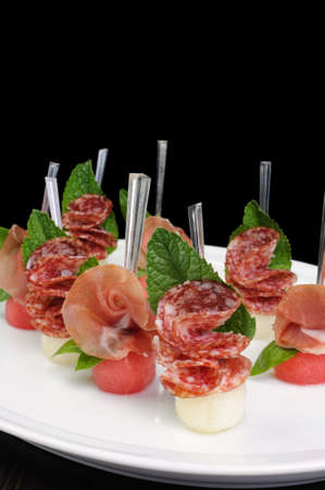 lunch hour: Canape of watermelon balls with a melon with gammon and salami
