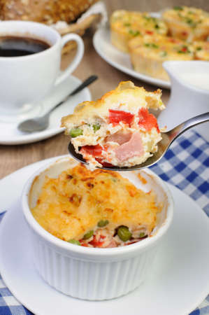 a portion: Baked vegetable casserole portion ham with cheese
