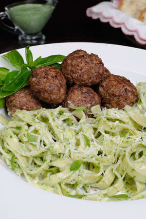 lunch hour: Meatballs with pasta sauce avocado,  parmesan and basil