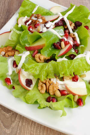 microelements: Salad of apples, cranberries , pomegranate, pine nuts and walnuts dressed with yogurt