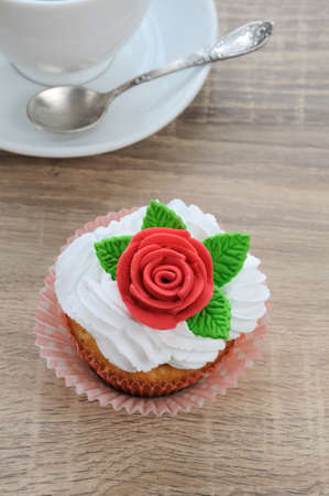 nosh: muffin of whipped cream decorated with marzipan rose