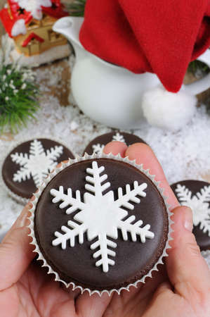 morsel: Chocolate Christmas Muffins decorated with marzipan pearl snowflake Stock Photo