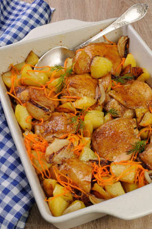 roasting pan: roast chicken with potatoes and vegetables in ceramic roasting pan