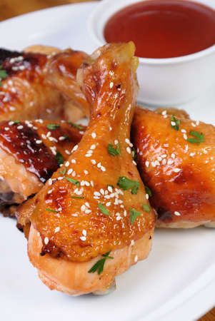 elevenses: Fried chicken leg with sesame seeds in a plate and sauce Stock Photo