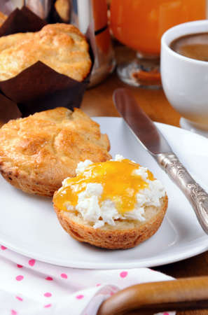 elevenses: Breakfast of bun with cheese cottage,  orange  jam on the tray