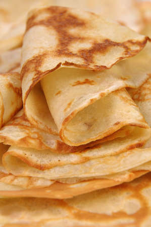 lunch hour: stack of folded crispy fried thin pancake closeup