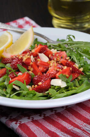 nosh: Salad of arugula and strawberries with crushed peanuts, almonds