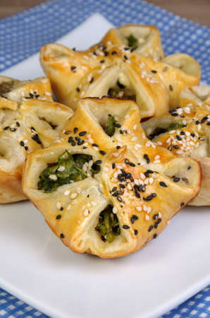 puff pastry with spinach and ricotta   on table