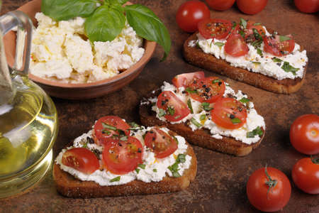 ration: Bruschetta with ricotta and cherry tomatoes seasoned   spices, basil