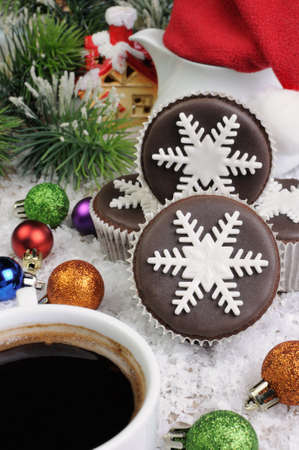 christmas paste: Chocolate Christmas Muffins decorated with marzipan pearl snowflake Stock Photo