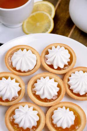 elevenses: plate of shortbread cookies with orange jam and cream