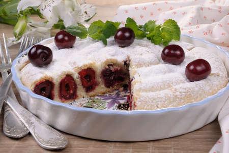 cherry pie pastry cut side under sugar powder