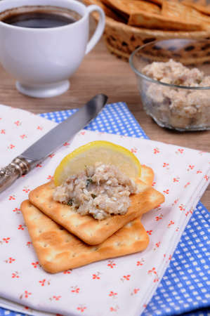 elevenses: Snack  of fish paste (forshmak) on a cracker with a cup of coffee Stock Photo