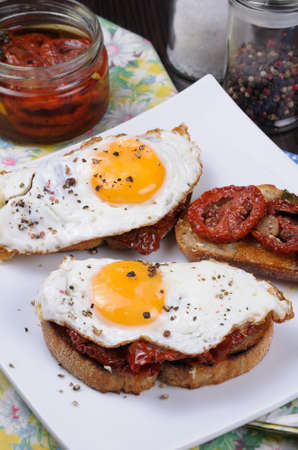 nosh: Sandwich with slices of dried tomatoes and egg flavored spices Stock Photo
