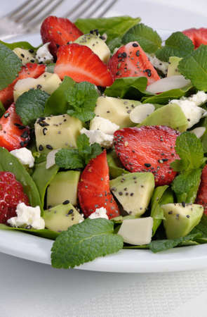 Salad spinach with strawberries, avocado, mint, ricotta and sesame,poppy seeds