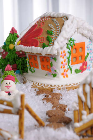 christmas paste: Gingerbread house painted in ethnic style among the trees and snow