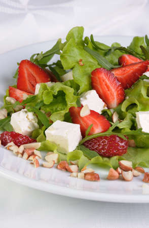 lunch hour: Salad of lettuce, arugula, strawberries, feta cheese and peanuts Stock Photo