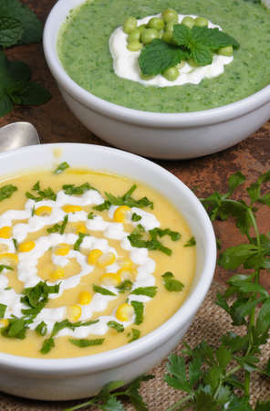 bowl of puree soup mealies and pea with herbs Stock Photo