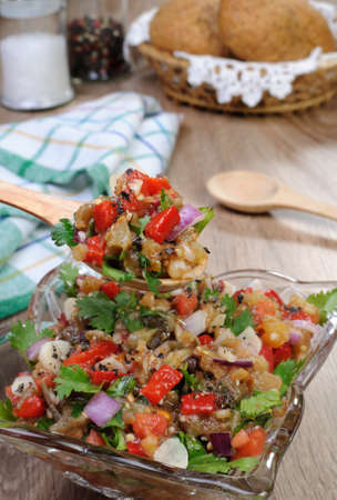 Salad of roasted eggplant with tomatoes, peppers, and cilantro