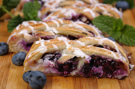 morsel: Pie stuffed with cheese cream , blueberry, crushed peanuts dough  braided plait