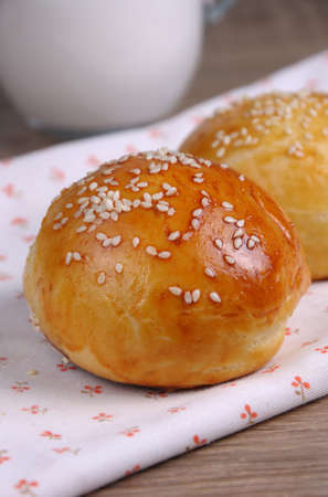 breadbasket: Buns with sesame seeds   on table closeup