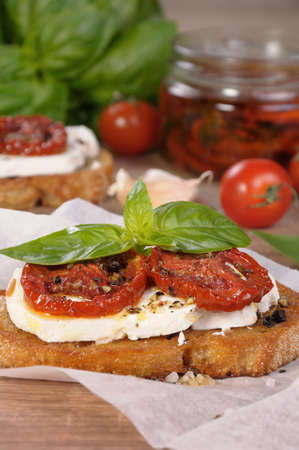 Bruschetta with feta and sun-dried tomatoes slices spiced Stock Photo