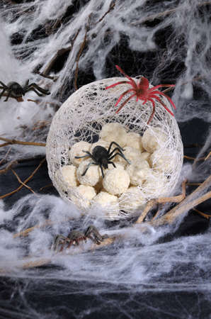 sweetstuff: candy waffle balls in the form of spider eggs in a cocoon with a spider on the table for Halloween