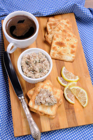 elevenses: Appetizer of fish paste (forshmak) on a cracker with a cup of coffee