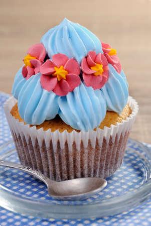 Muffin decorated with a delicate cream closeup