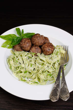 Meatballs with pasta sauce avocado,  parmesan and basil