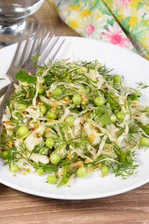 Coleslaw with cucumbers and peas, seasoned with dijon mustard and dill