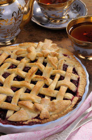 elevenses: cherry pie with decorative ornaments in  roasting pan