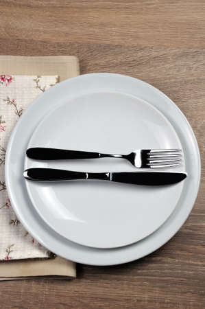 Dining etiquette - I still eat, finished  . Fork and knife signals with location of cutlery set Foto de archivo
