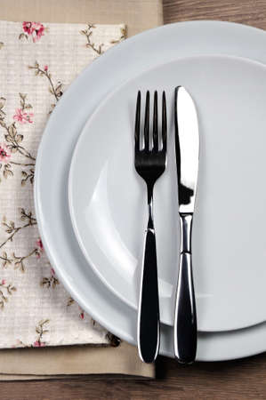 Dining etiquette - I still eat, finished. Fork and knife signals with location of cutlery set.